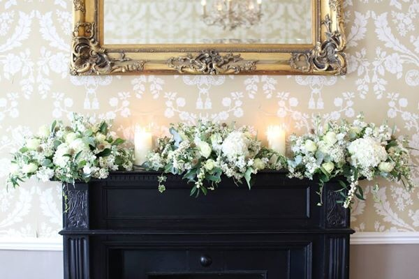 Floral Fireplace with Storm Lamps