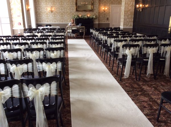 Ivory Organza Chair Sashes and a stunning Ivory Carpet
